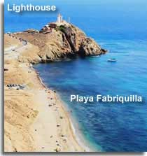 Playa Fabriquilla and the lighthouse on the Cabo de Gata headland