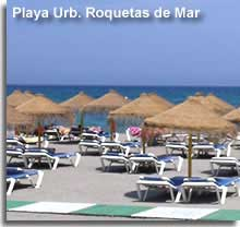 Sun loungers on the main beach of Roquetas de Mar