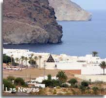 The village and black rock of Negras