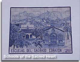 Image on the side of the church in Plaza Poveda of the Schools of the Sacred Heart in Guadix