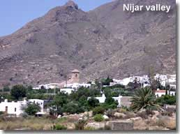 Descending Sierra Alhamilla through Nijar valley and the whitewashed village of Nijar