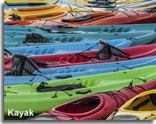Colourful kayaks on the beach